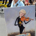 Grenfell May playing violin over coffin