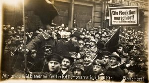 President Eisner with his wife surrounded by demonstrators, 16 February 1918. Poster reads: Reaction is on the march - long live the council system!