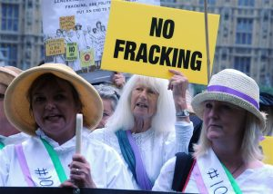 Suffragettes of today against fracking and for democracy outside Parliament